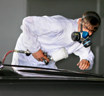 a CC student working in the auto refinishing lab