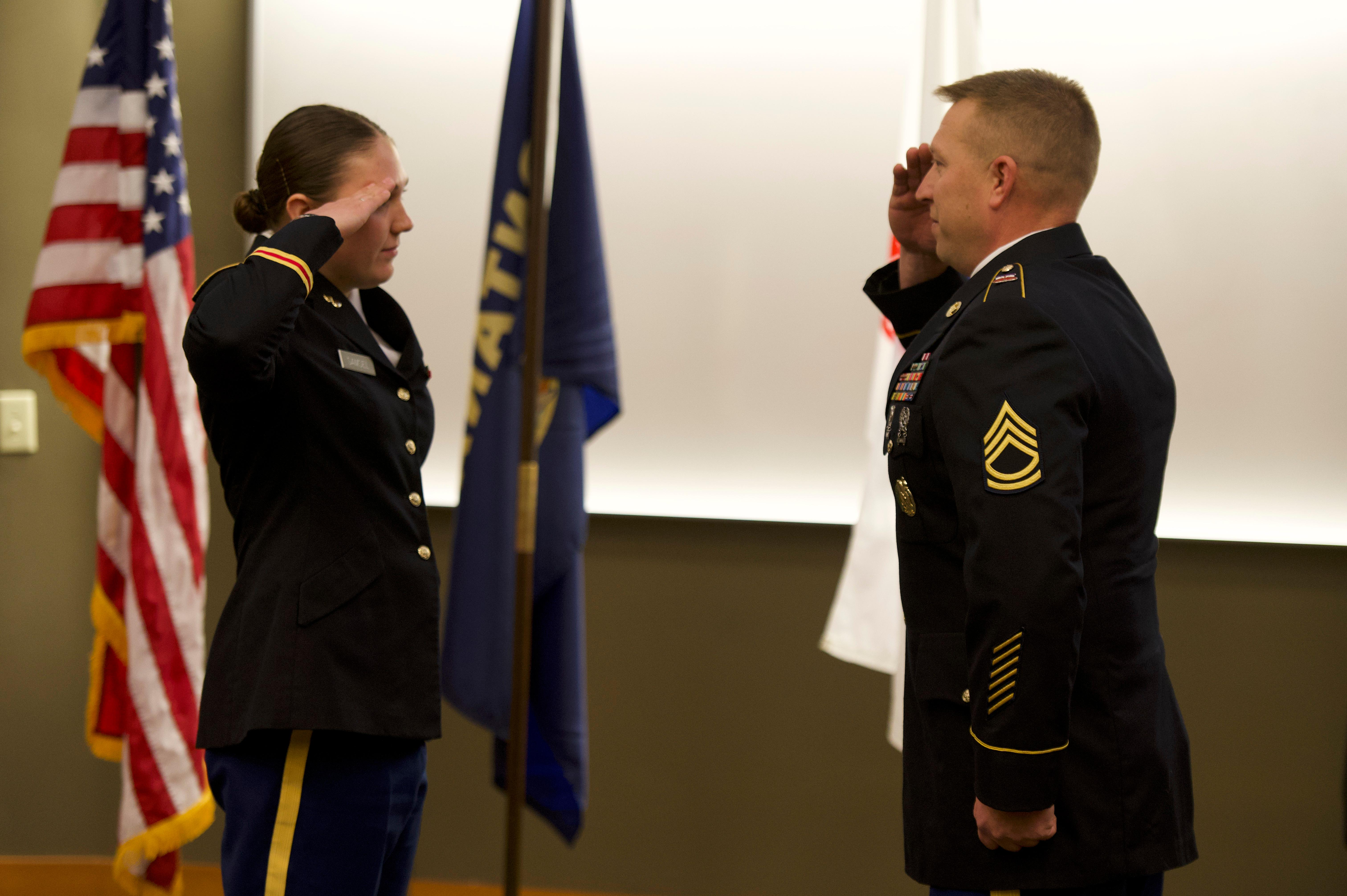 Cadet Haylee Samsel saluting an officer.