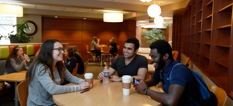 Three students at a table in Stinger's Bistro
