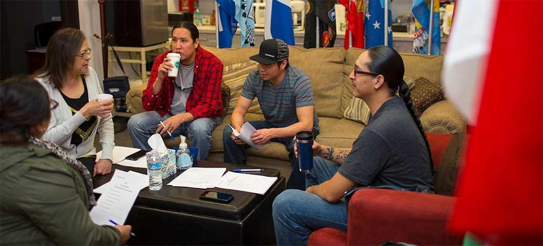 Native American students at a meeting