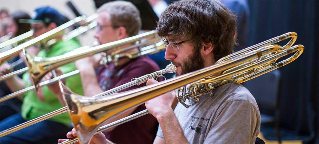 Students playing trombone.