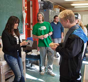 professor and students in a ceramics class