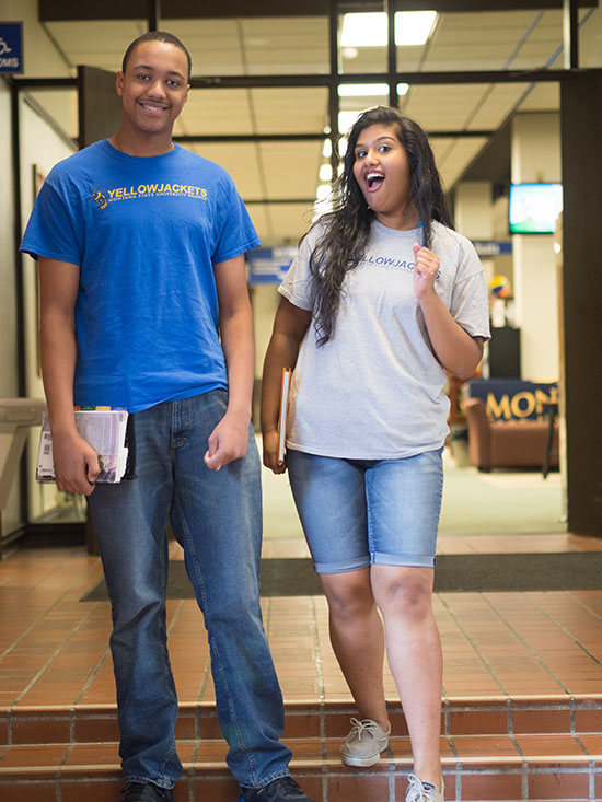 two smiling MSUB students standing in the Student Union Building