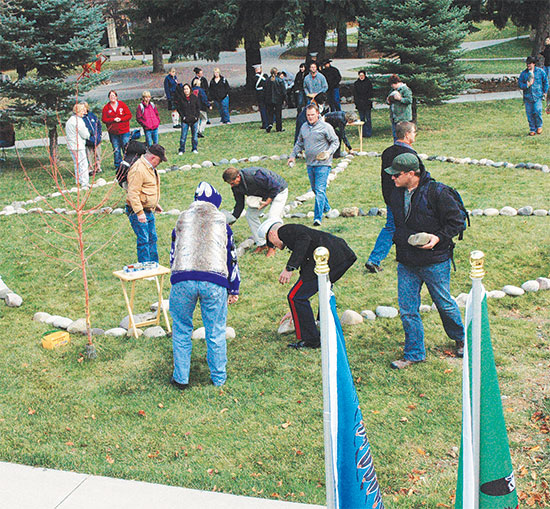 students and community members create a medicine wheel on the MSUB university campus