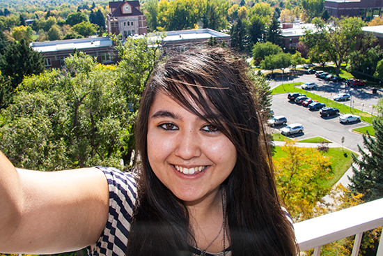 a student taking a selfie from the Petro Hall balcony