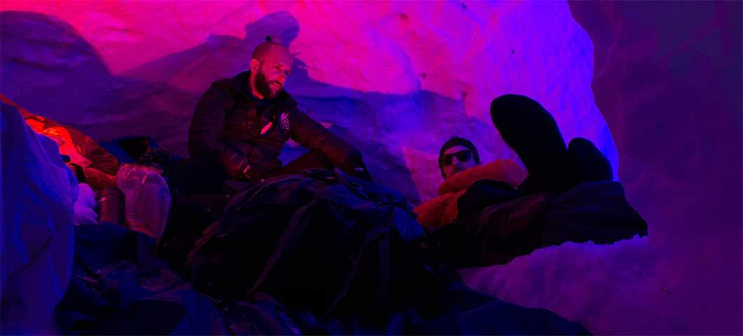 Students in a snowcave of sorts.
