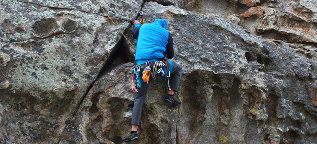 A student climbing a rock.