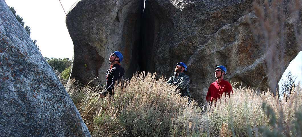 Students observing a climber.