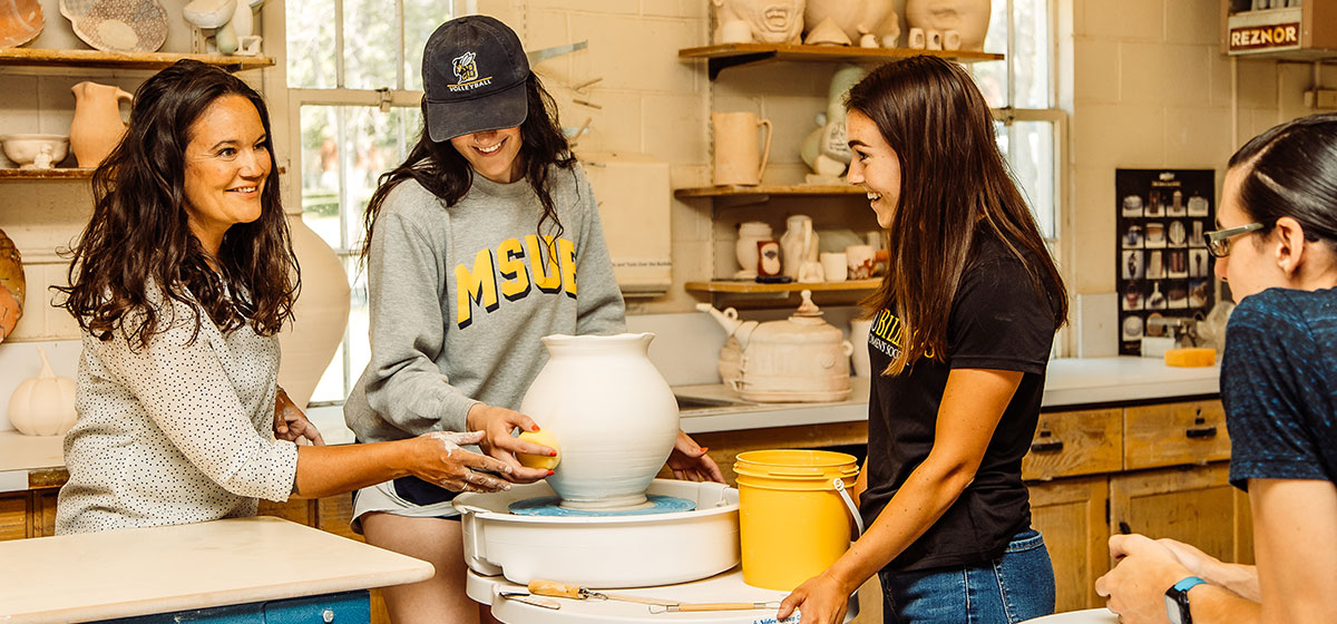 Students in a ceramics studio