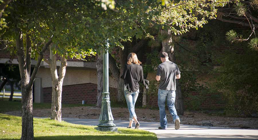 students walking together on the MSUB university campus