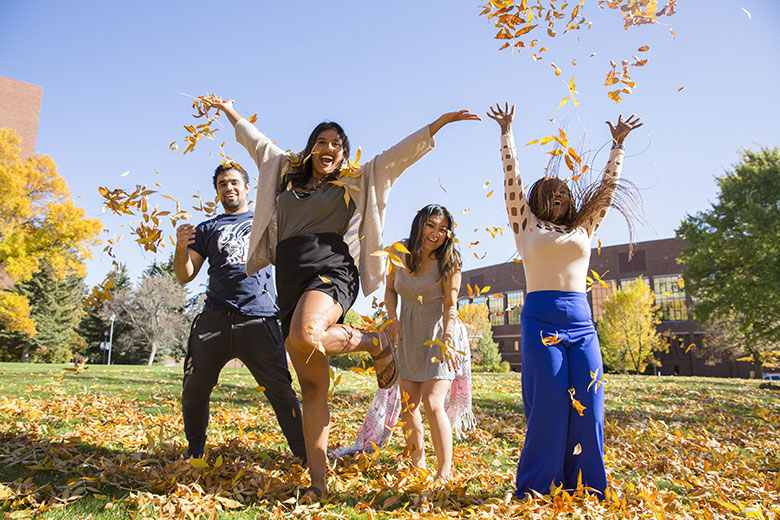 MSUB students playing in the fall leaves