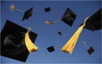 photo of mortarboards thrown into the air