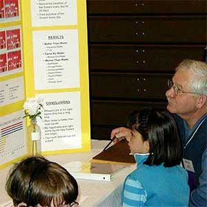 photo of a judge and student at a previous Science Expo
