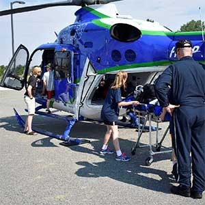 campers look over the St. Vincent Healthcare Help Flight helicopter