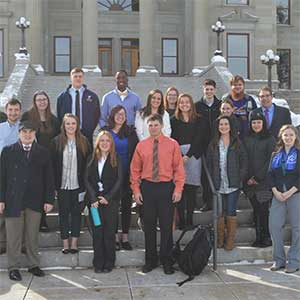 photo of students and faculty in Helena at the State Capitol Building