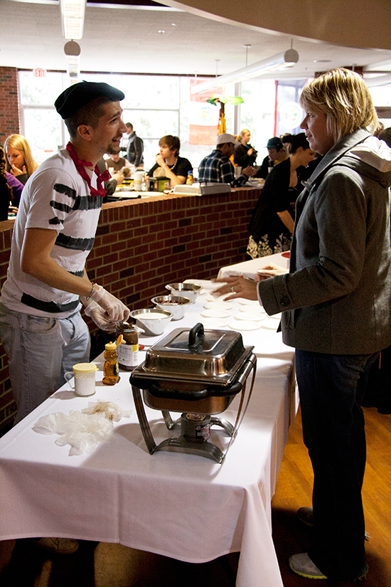 an international student serving food to a Billings resident