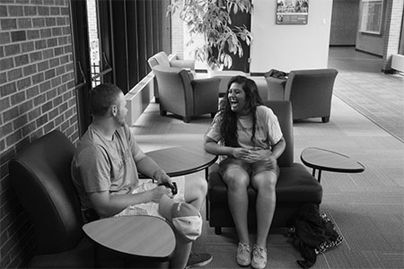 students relaxing outside the library