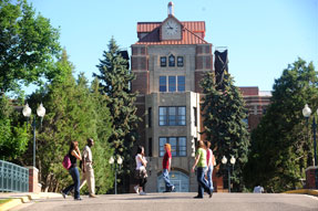 students cross campus in front of McMullen Hall on the main MSUB campus