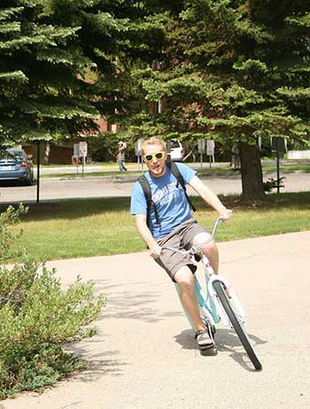 Student riding a bike