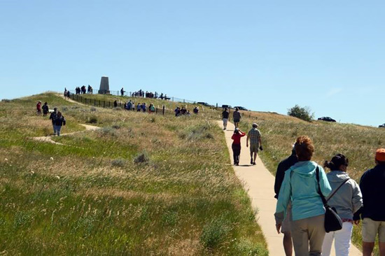 During the 140th anniversary celebrations visitors walk up the path to Last Stand Hill. Credit: NPS