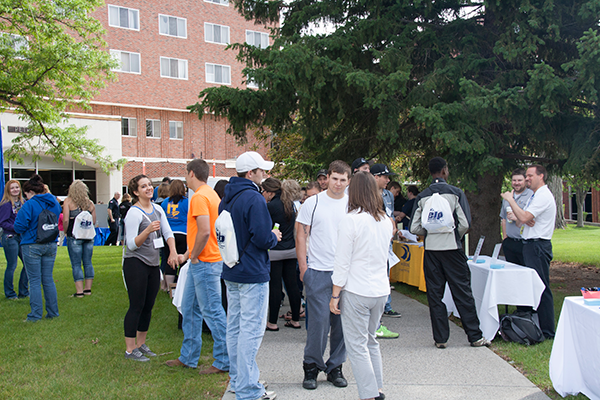 students mingle outdoors on the MSUB University campus